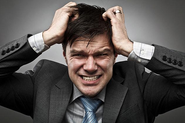 Businessman pulling his hair