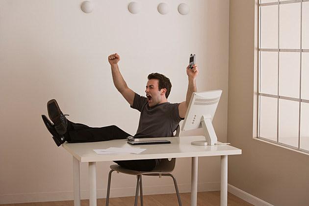 Man relaxing at desk